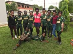 Kwanieze John surrounded by her team of youth players